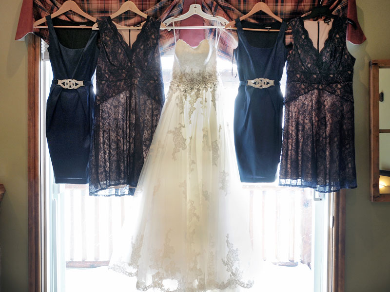 wedding dress with bridesmaids dresses in window