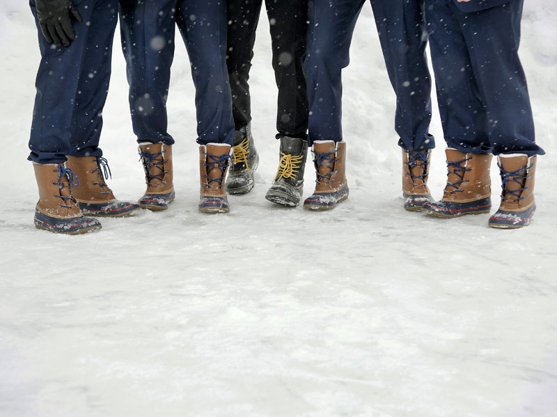 groomsmen boots in snow winter wedding