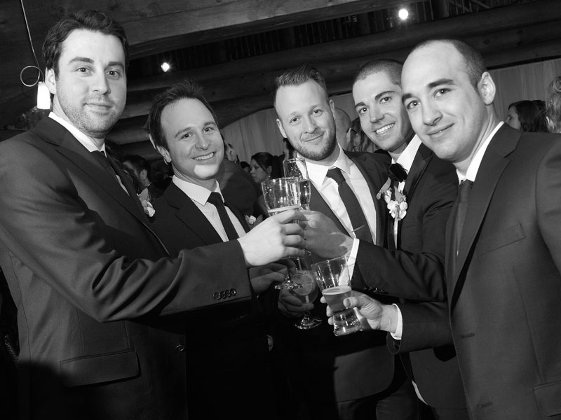 groom with groomsmen during cocktail hour