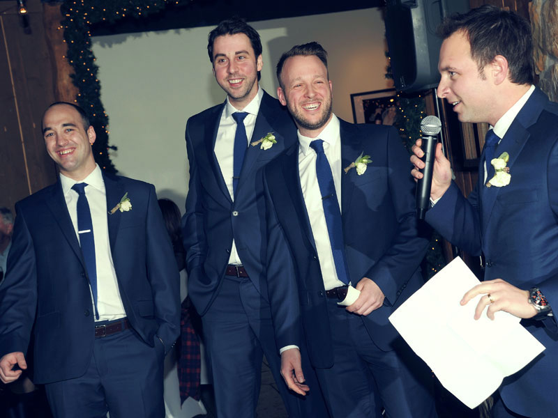 wedding photo of the groomsmen speech during the evening