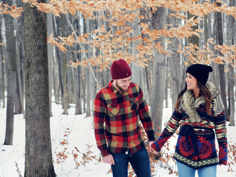 winter engagement session in the woods