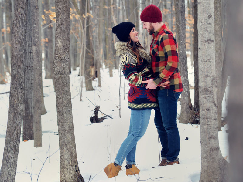 Future bride and groom in the woods
