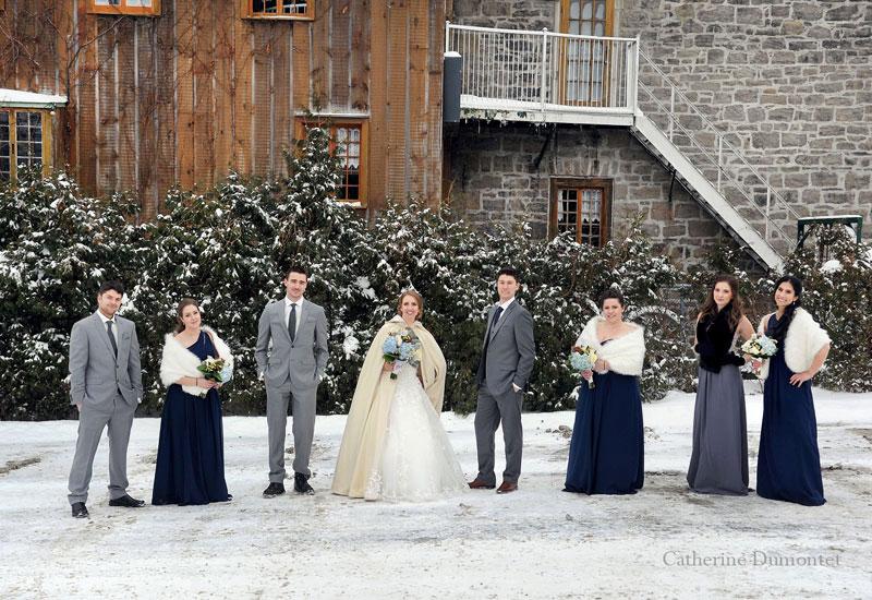 bridal party posing in snow