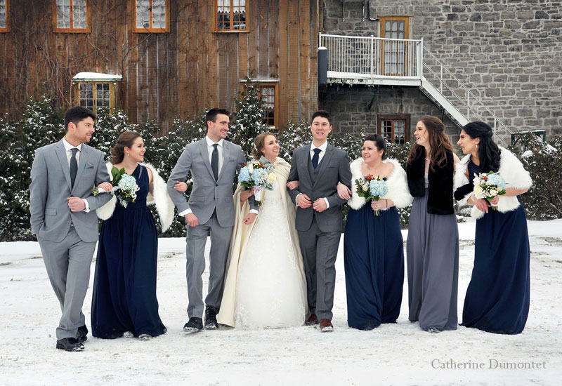 bridal party taking a walk in snow