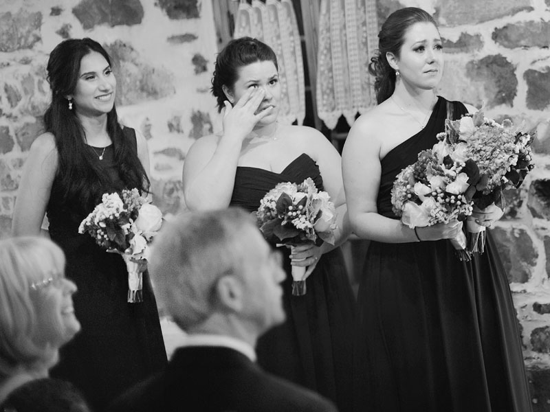 Crying bridesmaids during wedding ceremony