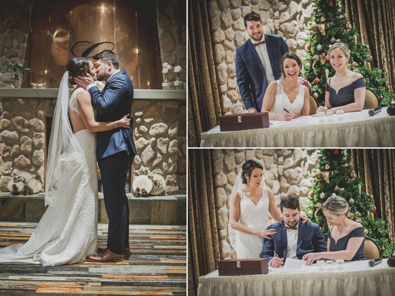 Les mariés s'embrassent et signent les registres