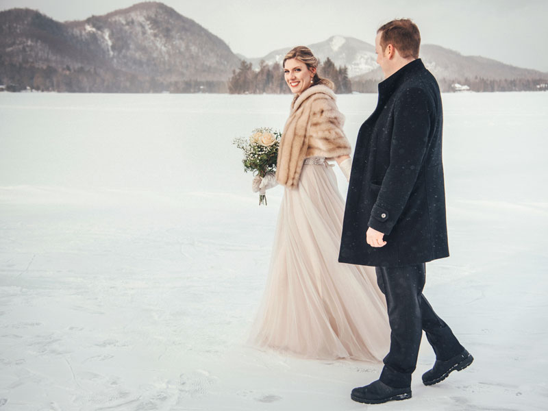 Newlyweds walking on Lac Superieur in Tremblant