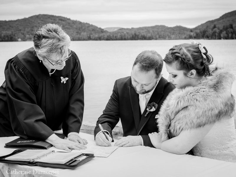Bride and groom signing papers