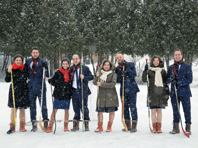 the bridal party with hockey sticks