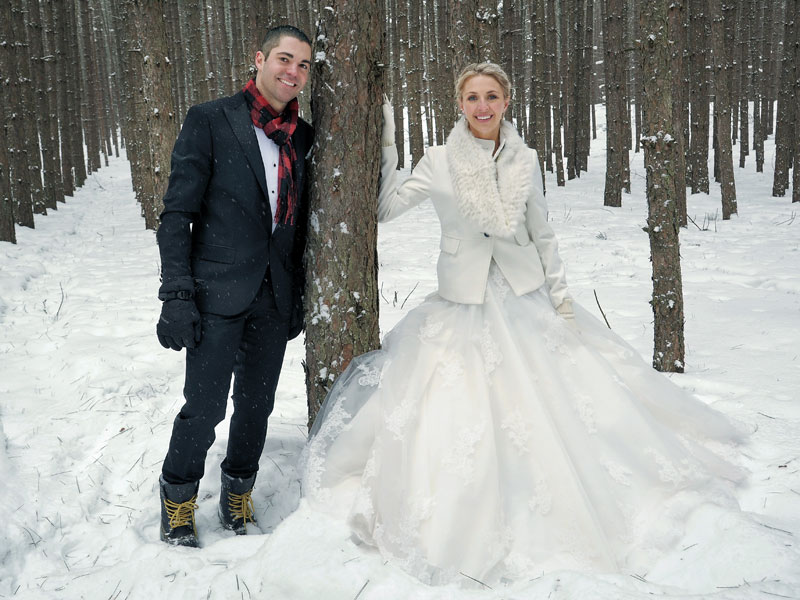 the bride and groom in the forest