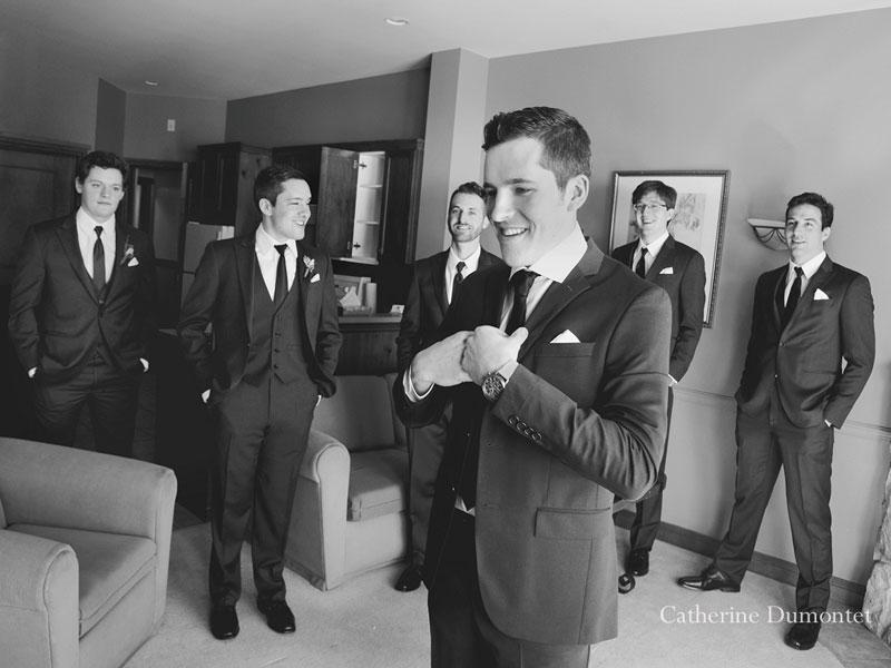 groomsmen watching the groom getting dressed