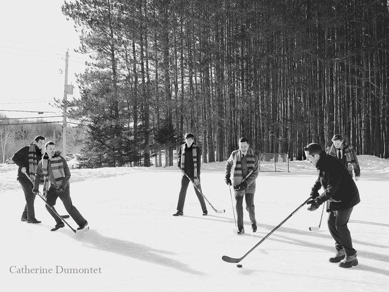 groom playing hockey with groomsmen