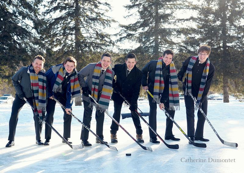 groom playing hockey with groomsmen