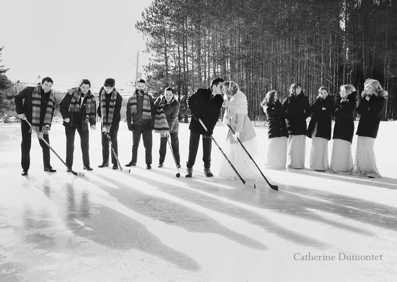 the bridal party on a hockey rink