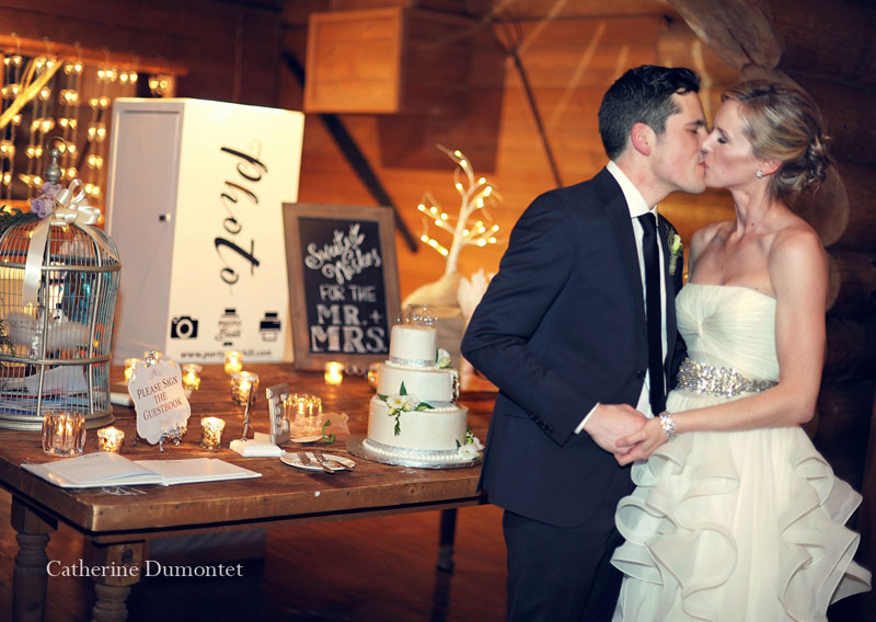 the newlyweds cutting the wedding cake