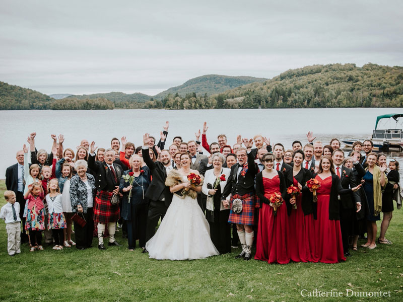 wedding group photo in front of lake