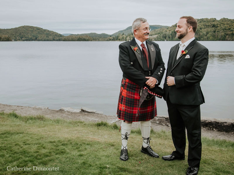 Groom and his father near the lake