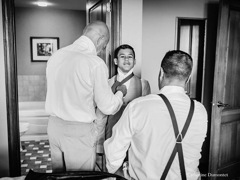 ring bearer getting ready at Sommet des Neiges