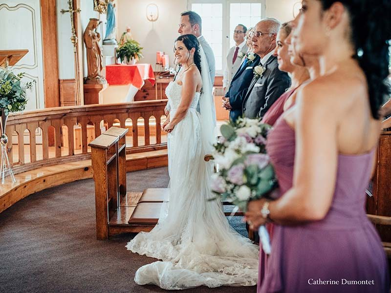 bride and groom at the Saint-Bernard Chapel in Tremblant