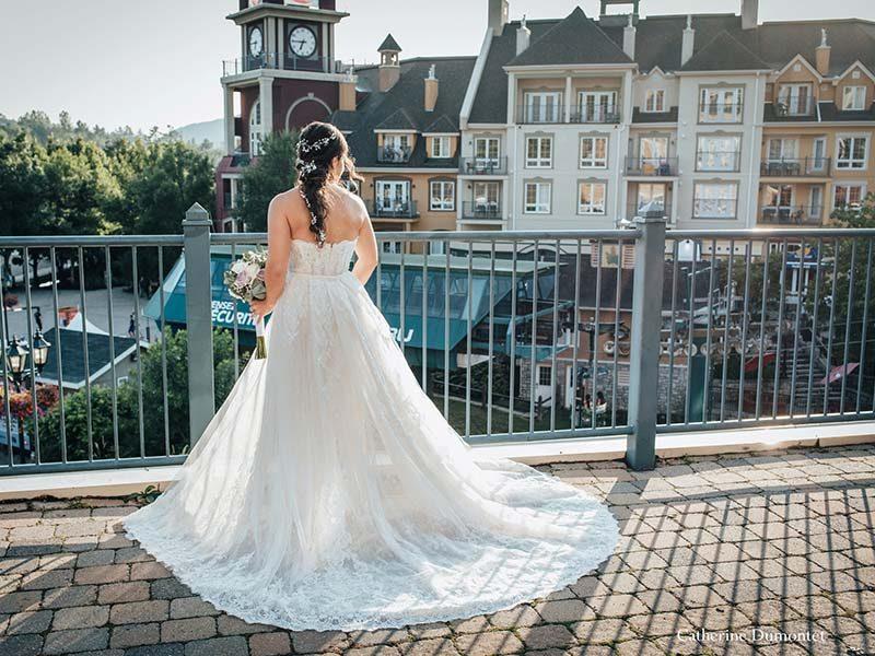 bride looking at pedestrian village in Mont-Tremblant