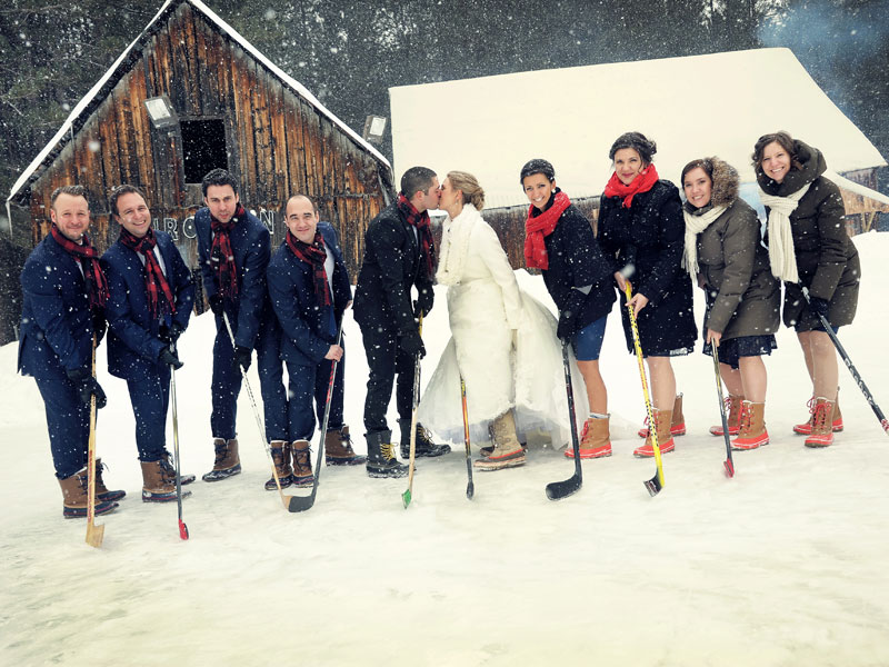 wedding bridal party playing hockey on ice