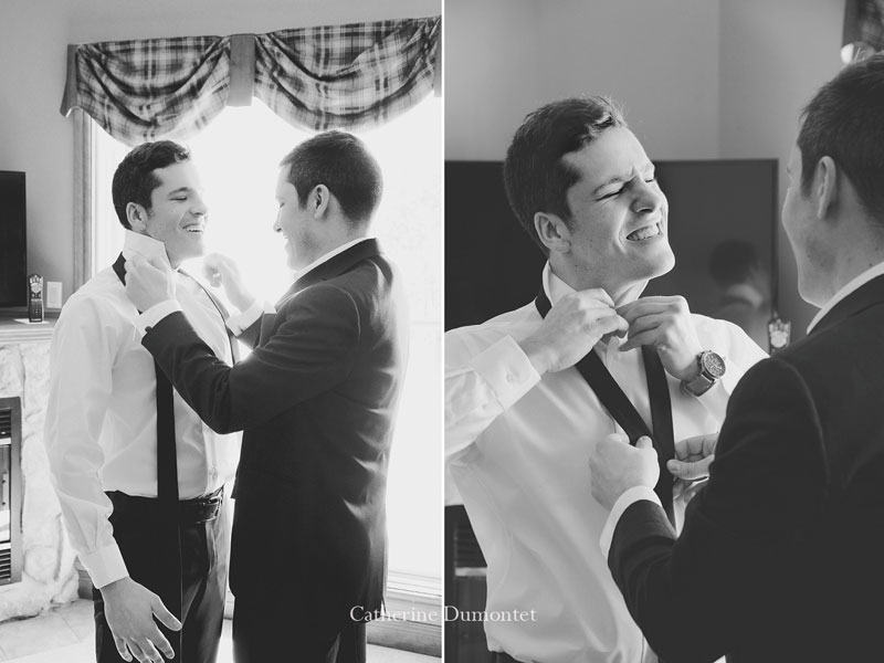 the groom putting on his tie
