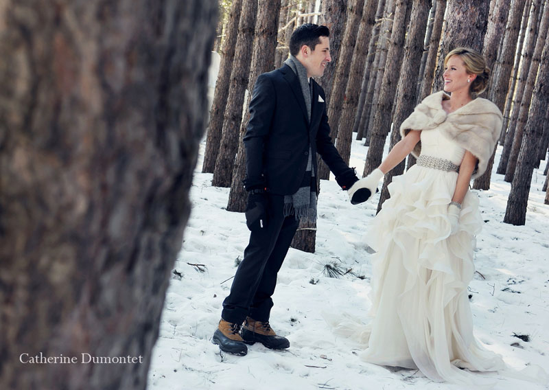 bride and groom in the woods of the Grand Lodge