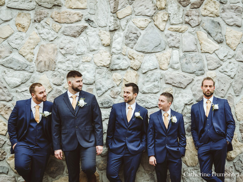 the groom and groomsmen at Hotel Mont-Gabriel
