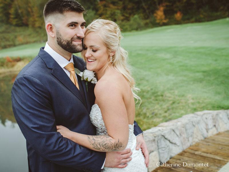 bride and groom on bridge at Hotel Mont-Gabriel