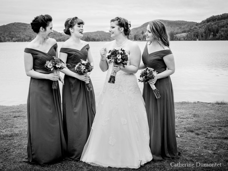 bride with bridesmaids in front au Lac Ouimet